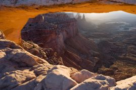 Sun rises through morning Arch, Utah