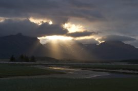 Light breaks through the clouds over Halo Bay, Alaska