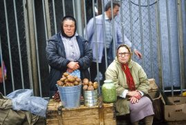 Women selling potatoes in market. Kuril Islands, Russia
