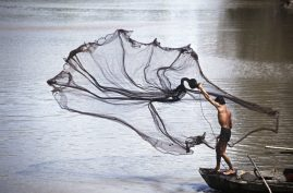 Man throwing a fishing net. Vietnam